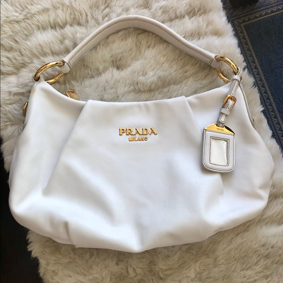 6dfefa70acbf38 Leather Prada Small Shoulder Bag in White. M_5b4b9a002beb791c3a5bfd8a